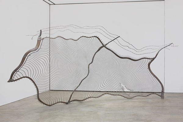 Robert Lazzarini, chain-link fence (Torn), 2012 steel and pigment; 134 x 276 x 75 inches.