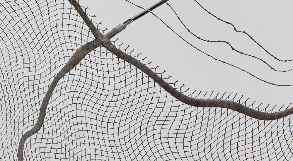 Robert Lazzarini, chain-link fence (Torn), 2012. steel and pigment; 134 x 276 x 75 inches Detail